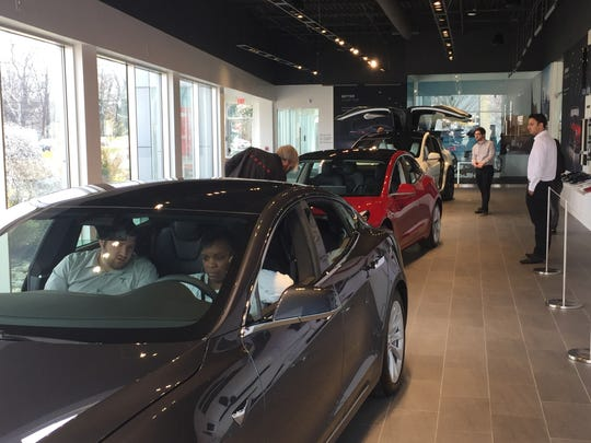 Three models are on display at a new Tesla showroom in Cherry Hill.
