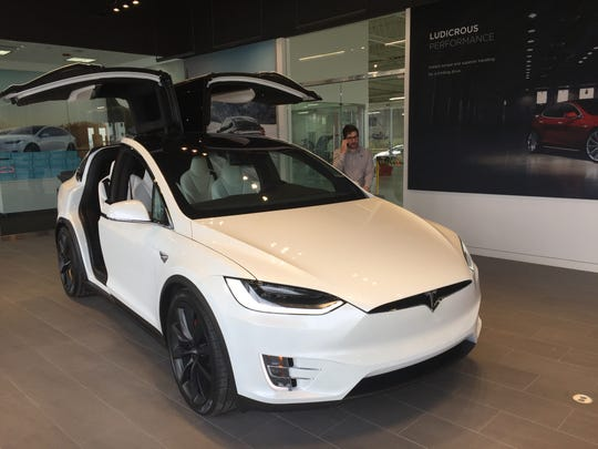 "The Tesla Model X features ""falcon-wing"" rear doors at the carmaker's new Cherry Hill showroom."
