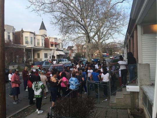 Community members gather Saturday for a vigil in memory