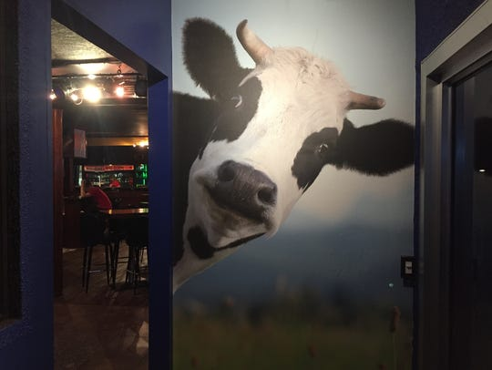 Don't forget to pay tribute to Millie the Cow on your way out of Wisco Grub and Pub.