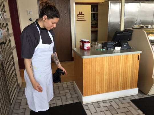 Bake N' Cakes co-owner Haleigh Mason points to renovation