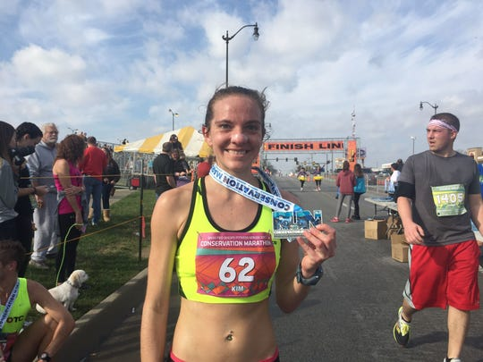In this file photo, Kim Reed shows her medal from winning the 2017 Bass Pro Marathon. Reed finished 8th in the Boston Marathon Monday morning.