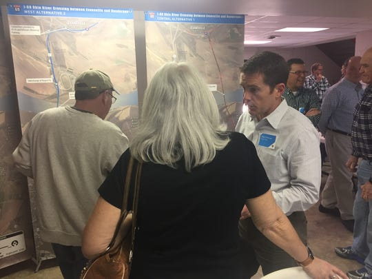 Dan Prevost, of the I-69 Project Team, talks to attendees at Wednesday's informational open house at The Gathering Place senior center in Henderson.