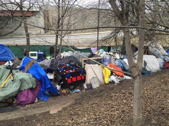 Homeless people have built homes for themselves on Spectrum's property on South Avenue.