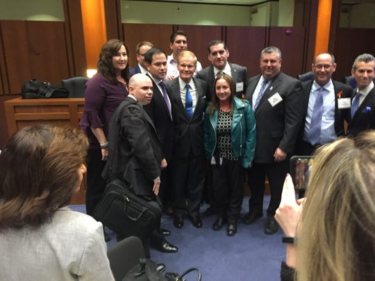 Senators Marco Rubio, R-West Miami, and Bill Nelson, D-Orlando have their pictures taken with a group after a school safety forum in Washington, D.C.