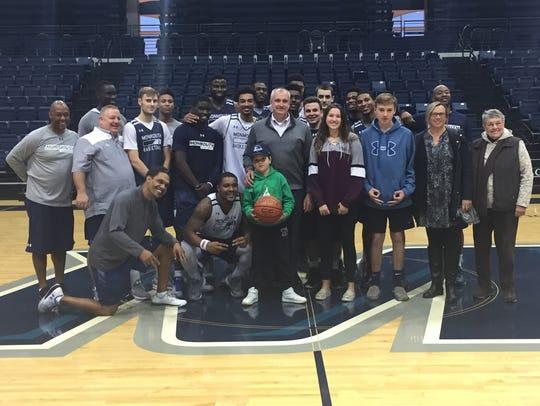 Members of the Monmouth University men's baketball