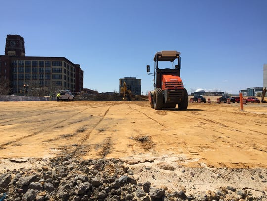 Construction equipment sits on the future site of 11