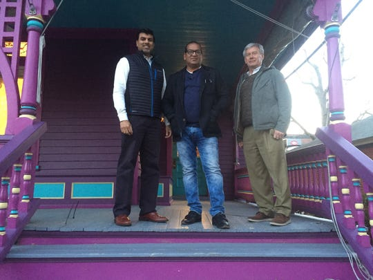 "Investor Dr. Vinay Hosmane, Chef Gyanendra ""GG"" Gupta and investor Dr. Mark Boytim stand on the porch of their soon-to-be Indian restaurant on Savannah Road in Lewes."