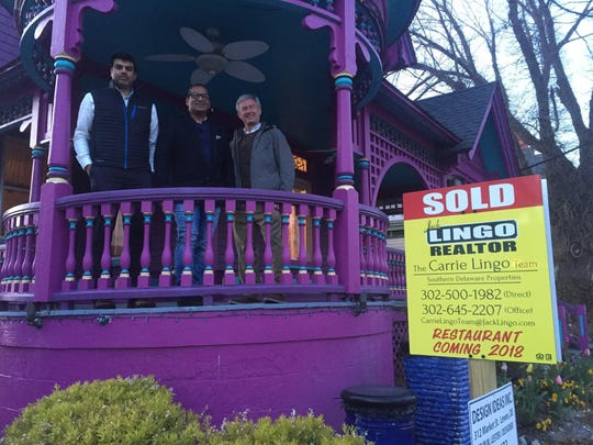 """Investor Dr. Vinay Hosmane, Chef Gyanendra """"GG"""" Gupta and investor Dr. Mark Boytim stand on the porch of their soon-to-be Indian restaurant on Savannah Road in Lewes."""
