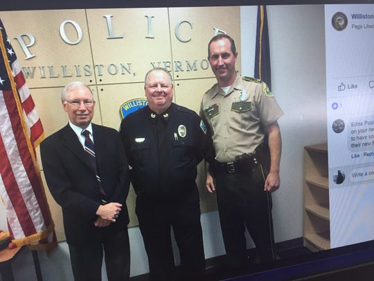 Williston Police Chief Patrick Foley, center, poses