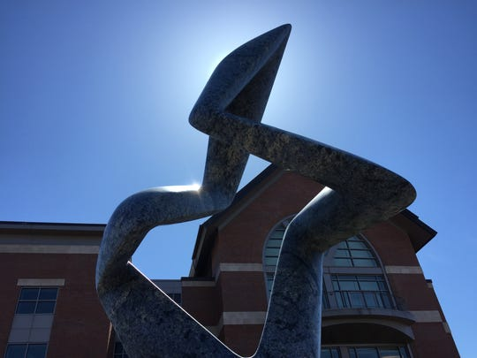 "Richard Erdman's ""Arete Blu"" is positioned on the second-floor ""green"" roof of the University of Vermont's Davis Center."