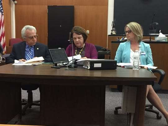 The Macomb County Election Commission, Treasurer Larry Rocca, Probate Judge Kathryn George and Clerk/Register of Deeds Kathy Brower, on April 24, 2018 discusses Macomb Township resident Tom Sokol's language on a proposed recall petition he filed against Township Trustee Dino Bucci, who was indicted in a federal corruption probe.