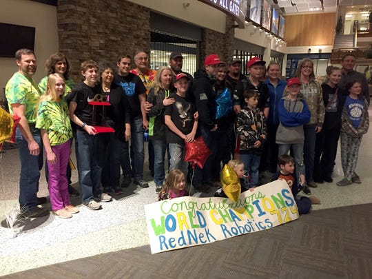 RedNek Robotics team members pose with family at the