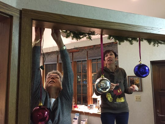 Karen Mathewson (left) and Mary Lubing decorate the