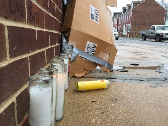This sidewalk memorial was erected at the spot where Nylik Moore, 18, was shot and killed last Tuesday.