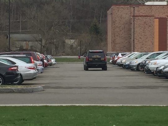 An IPD vehicle at Ithaca High School on Thursday.
