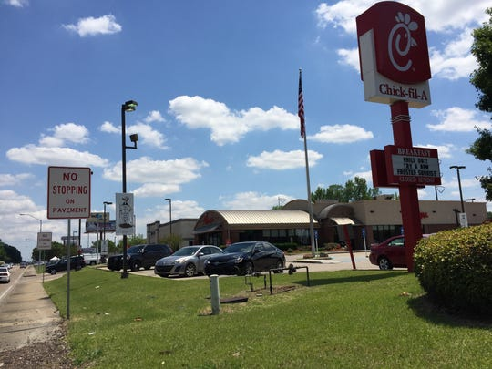 Traffic from Chick-fil-A's drive-thru often backs up on Ambassador Caffery Parkway.