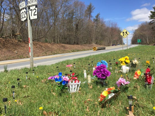 Flowers and items left near the scene of a shooting on Route 72 in Cornwall Borough that took the lives of two Reading men April 9, 2018.