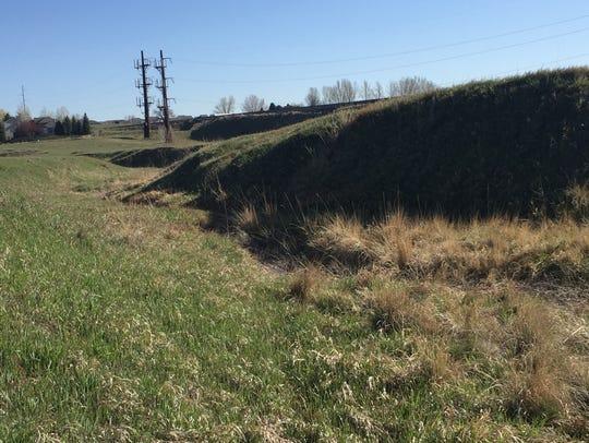 A deep ravine separates a disputed prairie dog colony