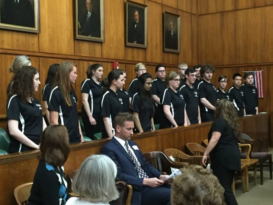 The Palmyra High School choir performed the Star-Spangled Banner and other musical numbers at the naturalization ceremony.