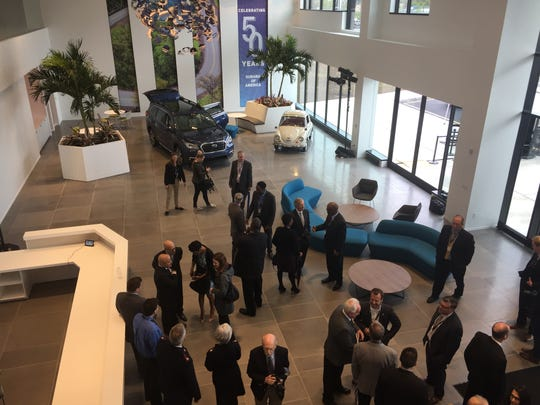 Visitors mingle Friday in the lobby of Subaru of America's new Camden headquarters.