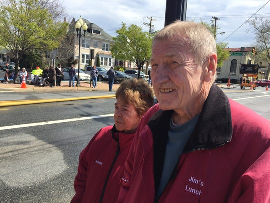 Rochelle and Jim Maul Sr., the two faces of Jim's Lunch in Millville, are seen here on April 27, 2018 on East Main Street watching demolition work that had forced their restaurant to temporarily close.