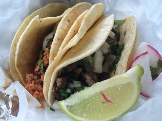Chorizo, left, and lengua tacos from El Azteca Taqueria