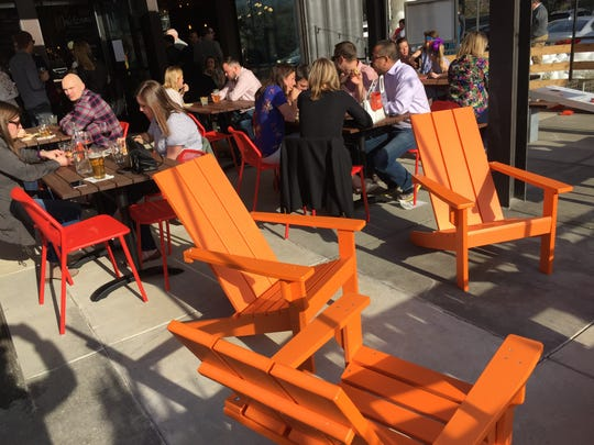 Easy chairs and picnic tables on the patio at Next