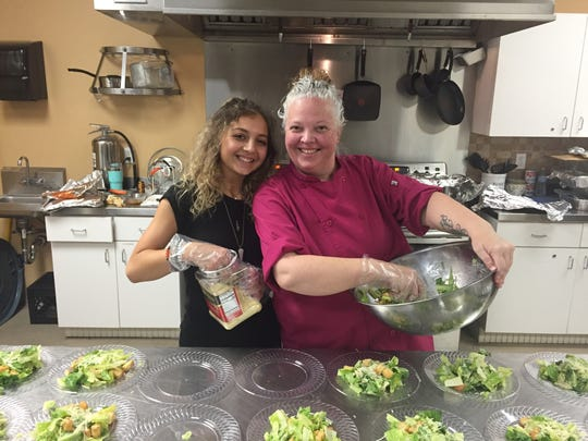 Volunteers Tierney Henkel and Kelly Henkel helped teach THRIVE program participants to prepare and cook a meal.