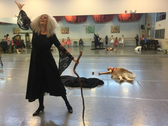 In this costume rehearsal, the wicked stepmother celebrates what she thinks is victory after Snow White bites into the poison apple in the Naples Ballet; performances are May  26 and 27.