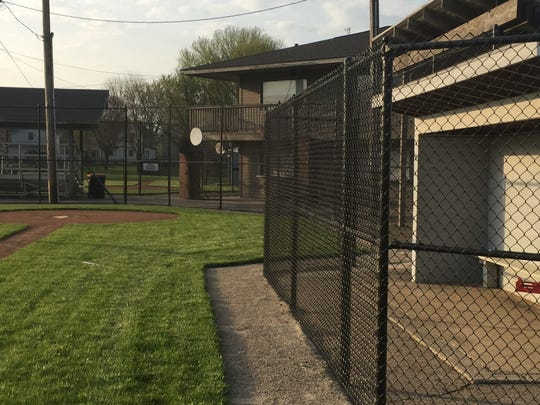 The dugouts at Mound City Park now have new fencing, plus a warning track in front of them.
