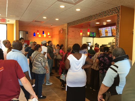 Throngs of hungry fried chicken lovers pack the inside of Popeyes on Cumerland St. in Lebanon on the store's opening day.