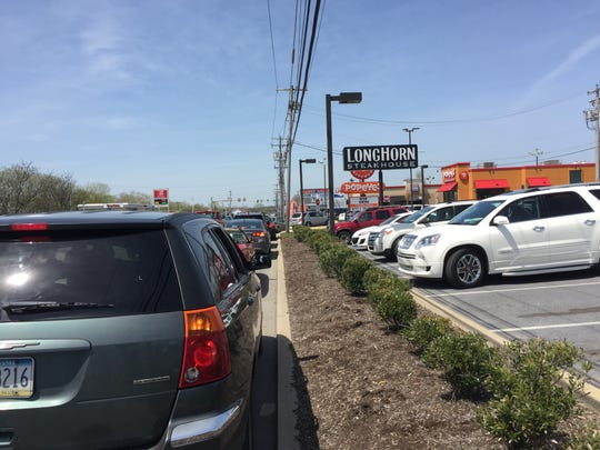 A shot of the cars along Route 422 waiting for the Popeyes drive thru, a line that stretched in front of LongHorn Steakhouse.