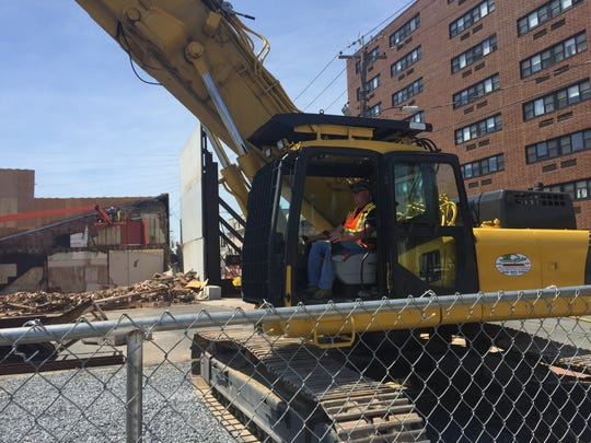 Contractor Billy Perryman repositions the excavator