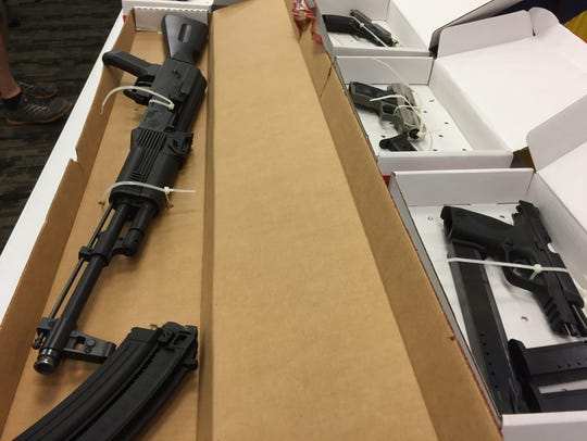 This rifle and clip, along with handguns, were seized
