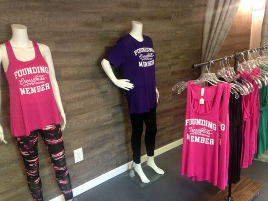 The fitness center features a boutique for women's workout gear.