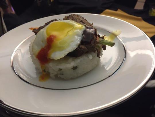A bulgogi-braised short ribs with green onion, rice