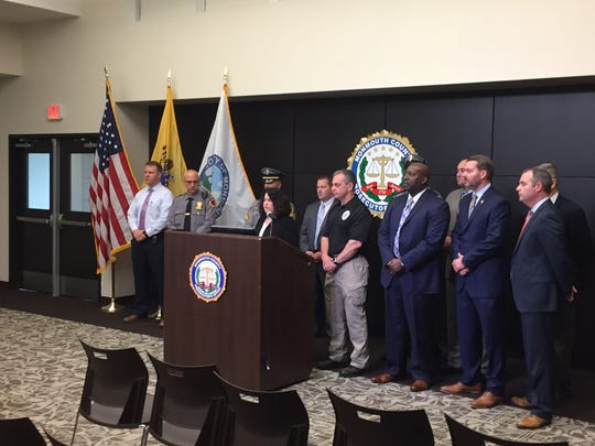 Monmouth County officials flank first assistant prosecutor Lori Linskey, as she leads a press conference on the arrest of Kader Mustafa, in the shooting death of Sciasia Calhoun..