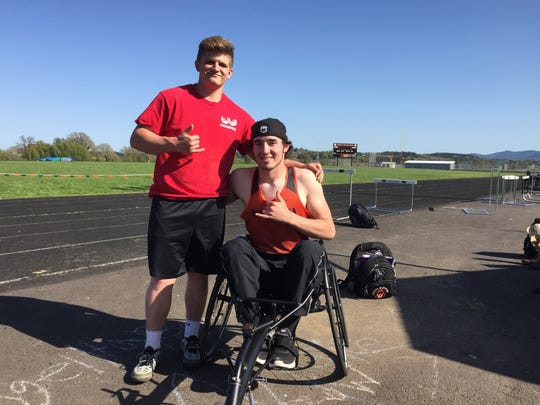 Willamina junior Andrew Kennedy (left) has been working with Owen Baker in the shot put. They've been friends since second grade.