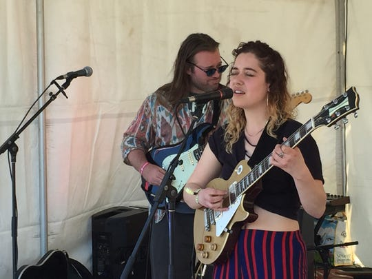 Burlington singer-songwriter Ivamae plays a set in the Winooski rotary on Saturday, May 5, 2018, during the Waking Windows festival.