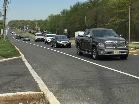 Motorists drive on Route 66 in Neptune. They are looking