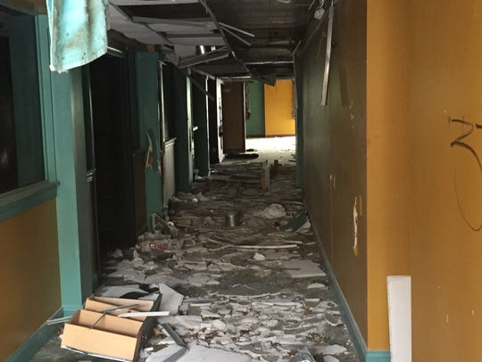 A debris-littered hallway leads to the former site of the Palace of Asia restaurant on Park Boulevard in Cherry Hill.