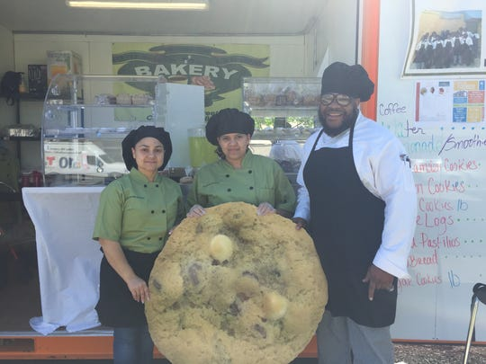 Respond Bakery's Luz Rivera, Andre Spruel and Yesenia Cordero are selling Camden Cookies, a popular local take on chocolate chip cookies, at the Lunch Box in Camden.