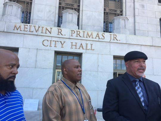 Troy Oglesby, right, has been camped outside City Hall
