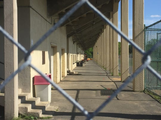 With demolition planned, fencing has been erected to secure the grandstands behind Collingswood High School.