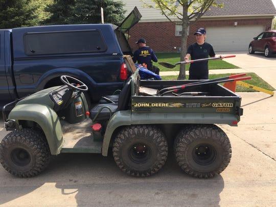 Michigan State Police Sgt. Sarah Krebs loads shovels