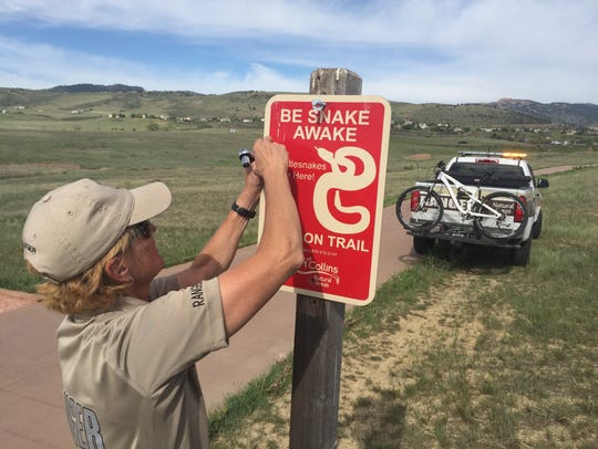 Rhonda Peckham, city of Fort Collins natural areas ranger, put up this sign in May 2018 warning trail users at the Cathy Fromme Prairie Natural Area to be aware of rattlesnakes, which have been seen on the trail.