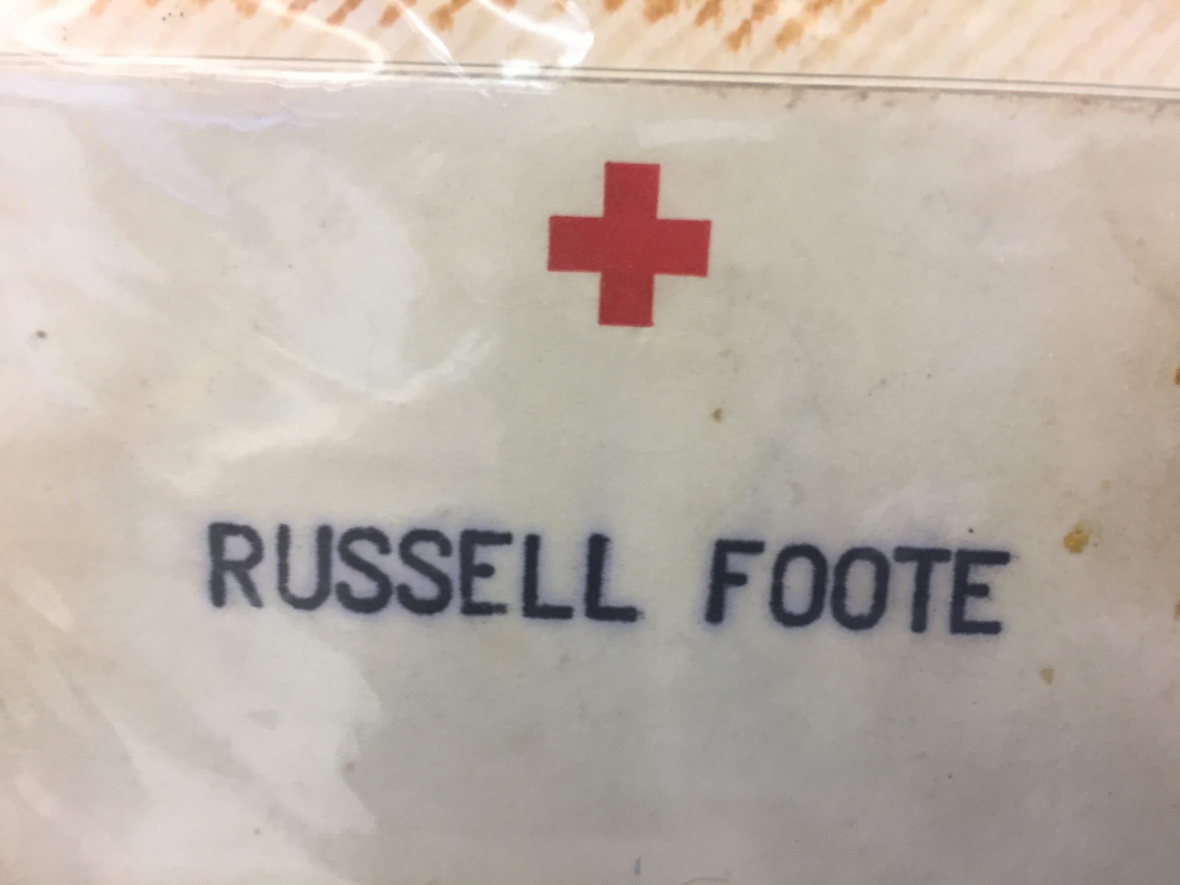 Russell Foote's Red Cross name tag.