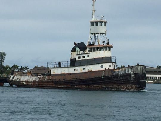 An old tug boat, 100 feet in length, was moved from