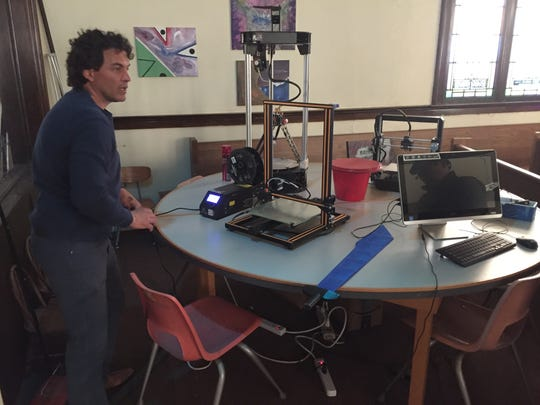 Jerry Norris, owner of The Fledge, showed off May 7 a 3D printer that made a sharp, blue sword.